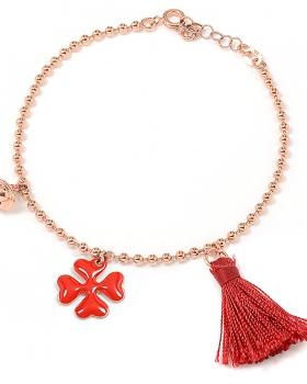 Bracciale in argento color oro rosa con campanella, nappa rossa e quadrifoglio smaltato